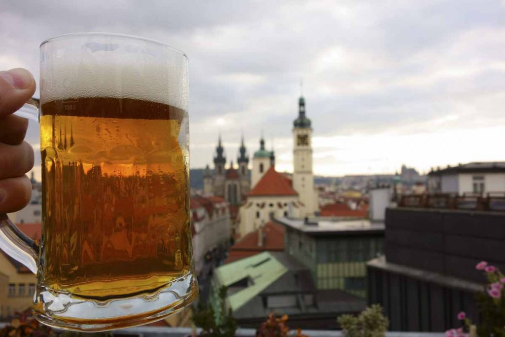 A fresh pint of Czech craft beer on a rooftop terrace in the cen